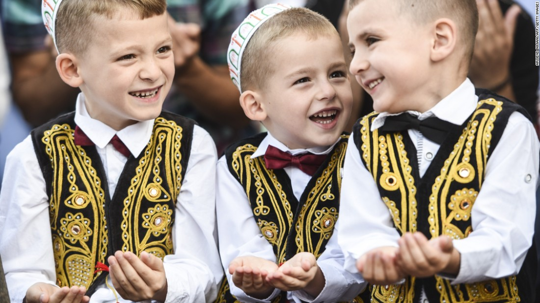 Young Kosovar Muslims take part in a prayer at the Sulltan Mehmet Fatih mosque in Pristina.