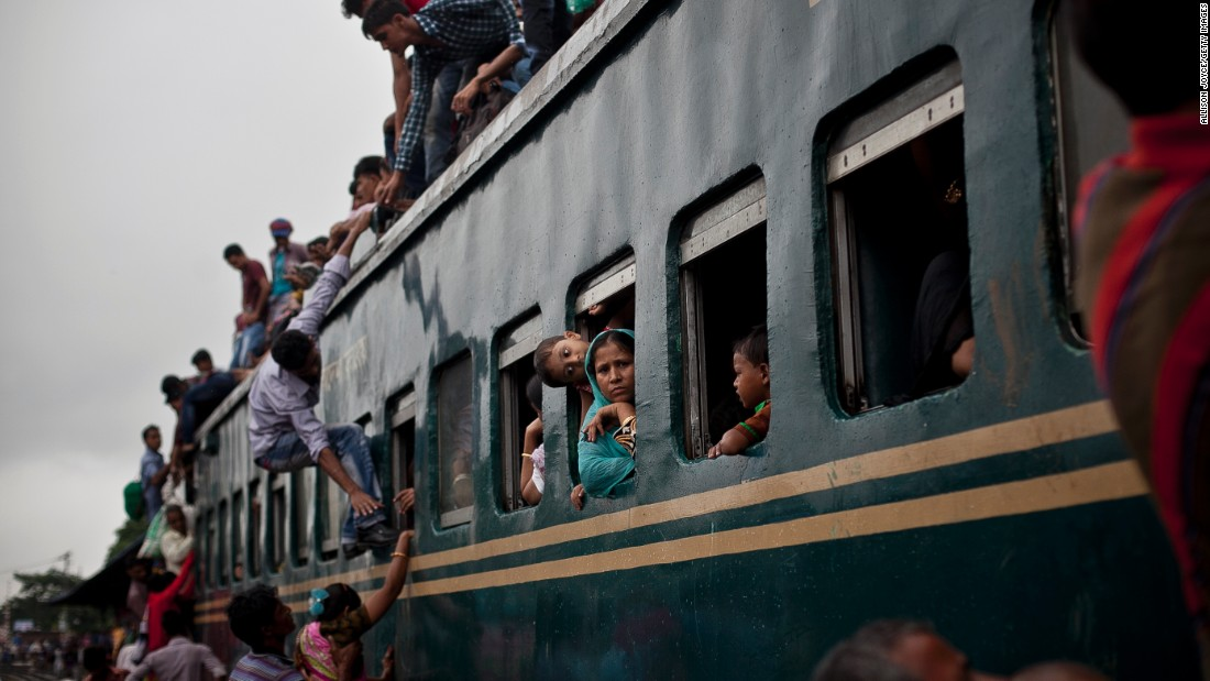 Muslims crowd onto a train to head home to their respective villages ahead of Eid in Dhaka, Bangladesh.