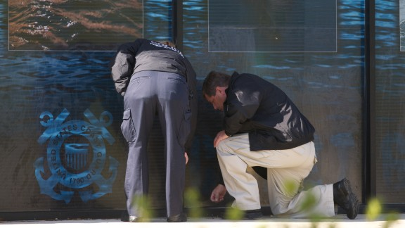 Investigators at the scene of a 2010 shooting.