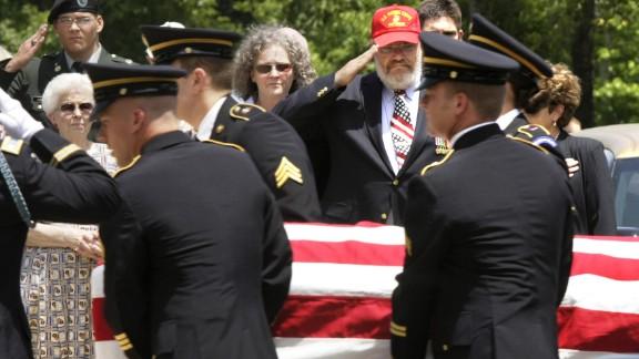Daris Long salutes the casket of his son.