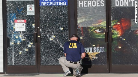 An FBI investigator works outside a military recruiting center where a  gunman opened fire Thursday 0c675406170c