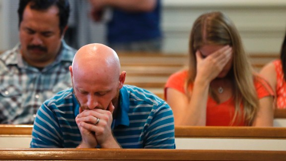 The Rev. Drew McCallie prays during a church service in Chattanooga on July 16.