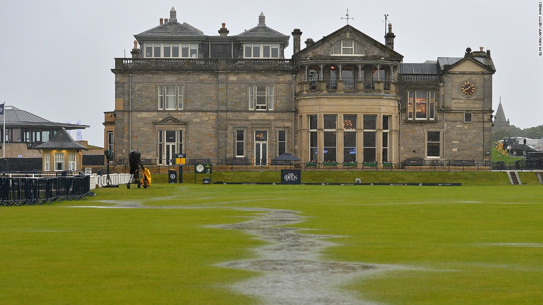 The heavens opened at 5 a.m. (BST) and quickly flooded the course, forming mini rivers in front of the famous old St Andrews clubhouse.