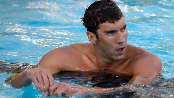 Michael Phelps reacts after his seventh place finish in the Men's 100 Meter Freestyle Final during the 2014 Phillips 66 National Championships at the Woollett Aquatic Center on August 6, 2014 in Irvine, California.