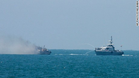 An Egyptian navy vessel hoses down another that caught on fire at the Mediterranean Sea on July 16, 2015.