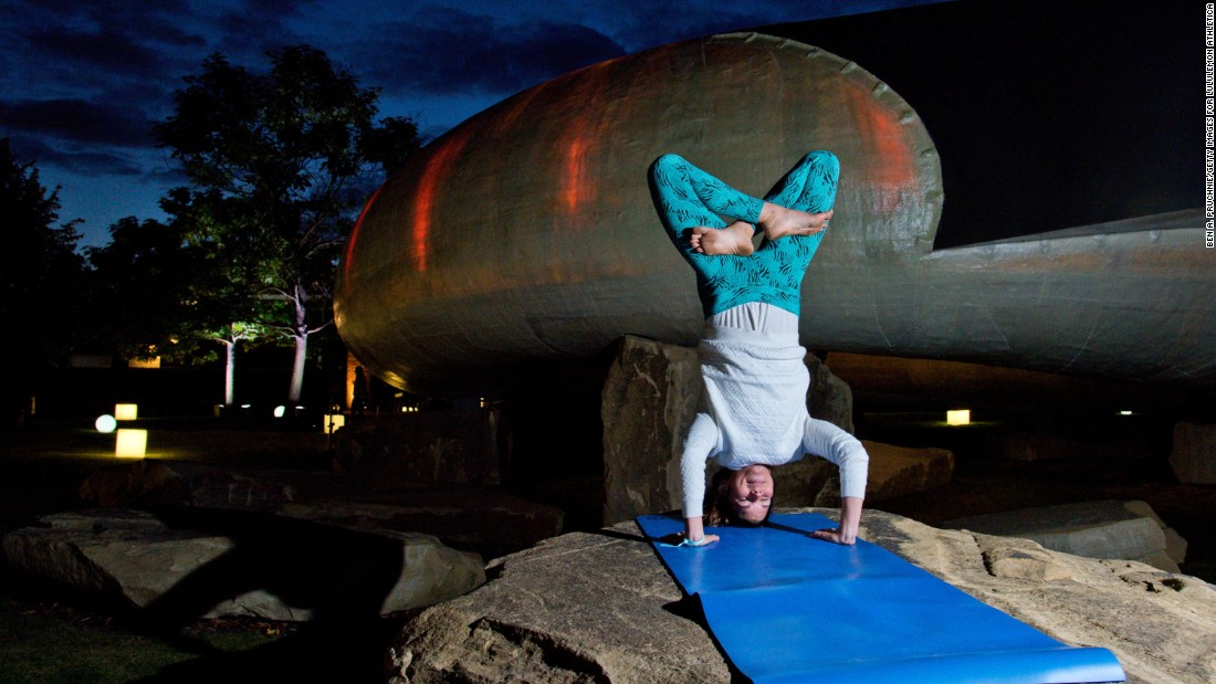 """The big things that all teachers hate are lateness, leaving early, and doing your own practice, "" says yoga instructor Mariza Smith. ""(Yogis) will kind of rock up and do their own thing."" This yogi is seen practicing a headstand at an outdoor yoga class at London's Serpentine Pavilion in August 2014."