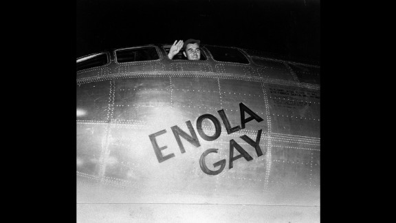 Air Force Col. Paul Tibbetts waves from the pilot's seat of the Enola Gay moments before takeoff on August 6, 1945. A short time later, the plane's crew dropped the first atomic bomb in combat, instantly killing 80,000 people in Hiroshima.