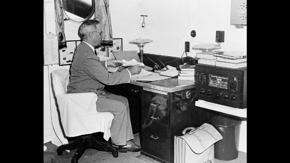 U.S. President Harry Truman, aboard a U.S. Navy cruiser, reads reports of the Hiroshima bombing. Eight days earlier, Truman had warned Japan that the country would be destroyed if it did not surrender unconditionally.