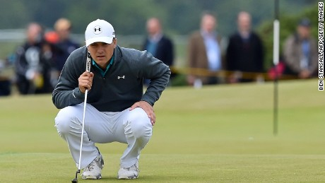 US golfer Jordan Spieth lines up a putt on the 4th green during his first round on the opening day of the 2015 British Open Golf Championship on The Old Course at St Andrews in Scotland, on July 16, 2015. Jordan Spieth got his bid for a third straight major title off to the best of possible starts at the British Open on Thursday, birdieing his first two holes and reaching the turn at five under 31.