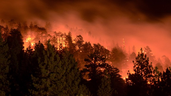 Flames from the Pines Fire burn on Saturday, July 18, in Wrightwood, California. The blaze was burning near Mount San Antonio, which is also called Mount Baldy for its snow-capped summit that