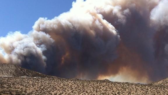 Smoke from a wildfire rises above Interstate 15 near San Bernardino, California, on July 17.