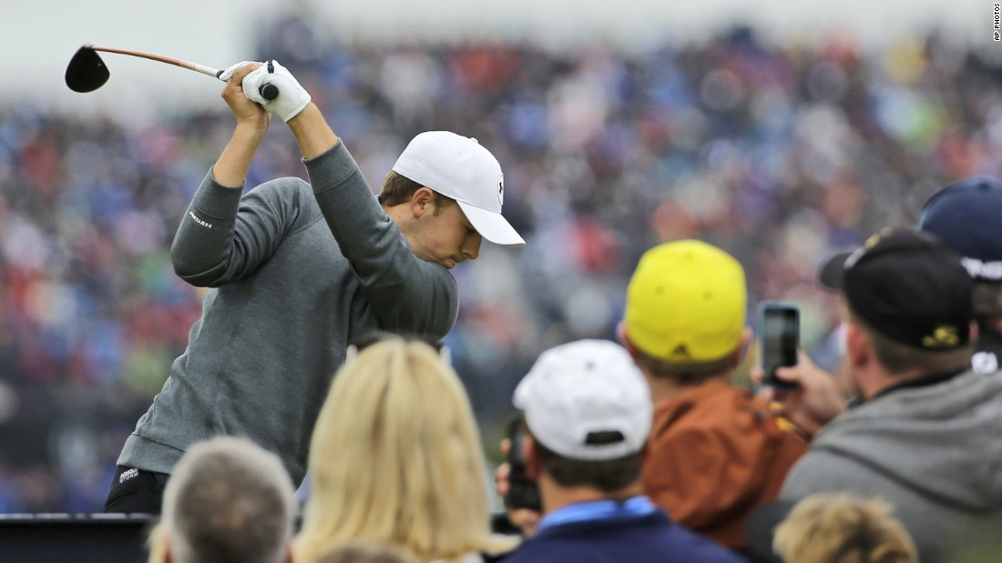 Texan Spieth drives off on the seventh watched by a large gallery.