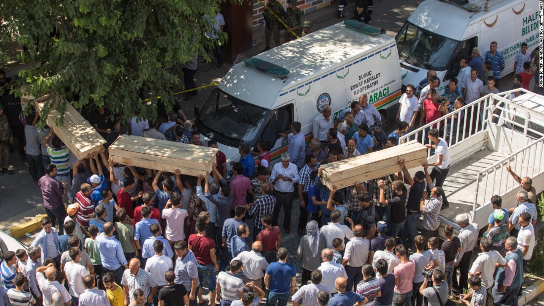 People carry coffins from the scene of the explosion on July 20.