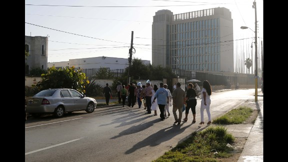 Cubans expecting their visas to the United States cross the street to enter the U.S. Embassy in Havana on July 20.