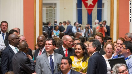 Visitors mingle in the newly reopened Cuban embassy in Washington, on Monday, July 20.