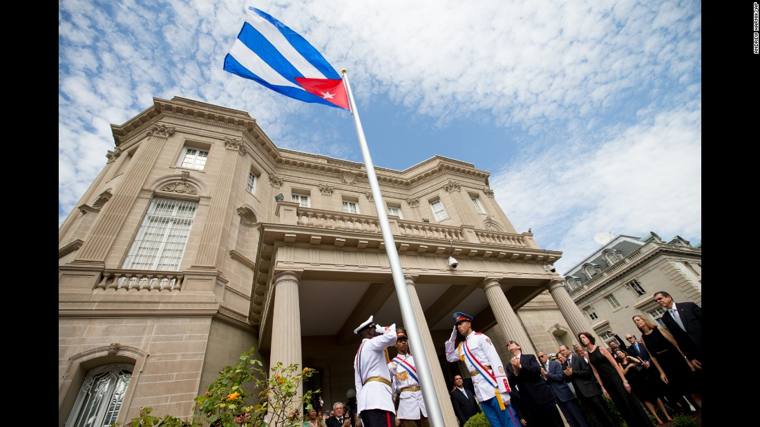Dignitaries applaud as the Cuban flag is raised over a reopened embassy in Washington on Monday, July 20. The symbolic move signals the start of a new era in U.S.-Cuba relations, and it came on the same day the U.S. Embassy opened in Havana, Cuba.