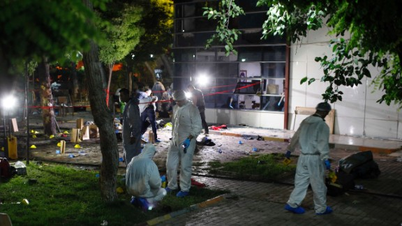 Forensic teams and police officers work at the site of a bomb attack in Suruc, Turkey, on Monday, July 20. More than 30 people were killed and at least 100 others were wounded in what Turkish officials called a terrorist attack.