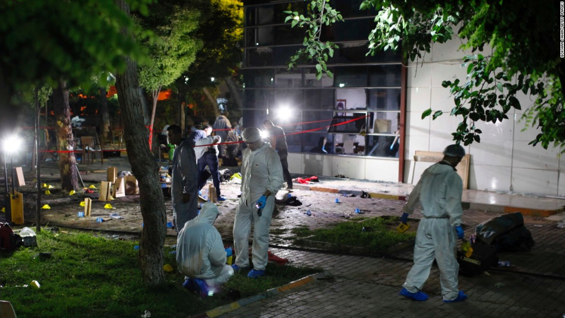 "Forensic teams and police officers work at the site of <a href=""http://www.cnn.com/2015/07/20/world/turkey-suruc-explosion/index.html"" target=""_blank"">a bomb attack</a> in Suruc, Turkey, on Monday, July 20. More than 30 people were killed and at least 100 others were wounded in what Turkish officials called a terrorist attack."