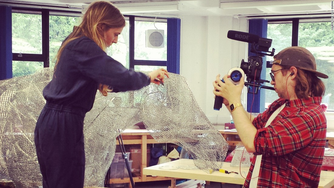 Dumon (left) at work on her Ascot sculpture. The 24-year-old uses chicken wire which she cuts into pieces and reshapes.