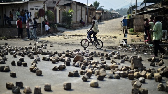 A man rides past a barricade set up by protesters in Bujumbura on July 21. Animosity against Nkurunziza boiled over in April when he expressed his intention to run for a third term. There have been protests and a failed coup.