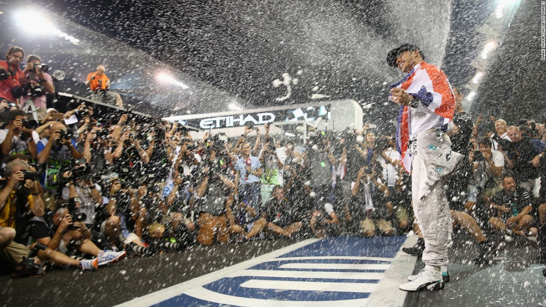 "As a photographer, Thompson is always looking for a show of emotion from the driver. ""Lewis Hamilton is pretty good, he's always happy to win,"" he says. This photo sees Hamilton celebrating finally winning the 2014 World Championship at the Abu Dhabi Grand Prix."