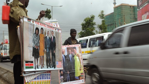 Street vendors show photos of Obama, first lady Michelle Obama and Kenya
