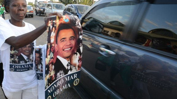 Posters with the image of Barack Obama are offered for sale to motorists in Nairobi, ahead of the U.S. president