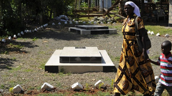 A visitor walks past the graves site of Barack Obama senior at the homestead of Sarah Onyango Obama, the President