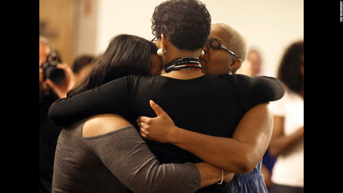 Geneva Reed-Veal, Bland's mother, hugs family members at a memorial service for her daughter July 21 in Prairie View.