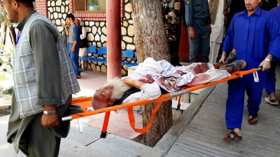 An injured man is carried out on a stretcher after a suicide attack in Faryab province north of Kabul, Afghanistan, Wednesday, July 22.