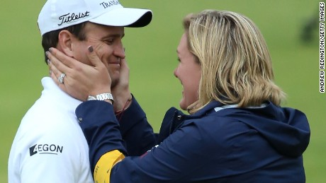 Zach Johnson of the United States celebrates with wife Kim Barclay Johnson after winning the 144th Open Championship at The Old Course during a 4-hole playoff on July 20, 2015 in St Andrews, Scotland. (Photo by Andrew Redington/Getty Images)