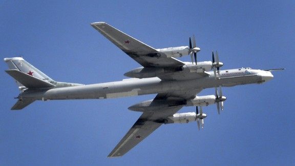 A Russian Tupolev Tu-95 turboprop-powered strategic bomber flies above the Kremlin in Moscow, on May 7, 2015, during a rehearsal for the Victory Day military parade.