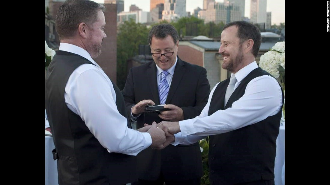 "After 13 years together, Greg Smith, left, and Jack O'Leary, right, officially wed in Boston on their anniversary, June 6, 2015. The ceremony was officiated by O'Leary's twin brother Tom O'Leary, center, captured by <a href=""http://www.lisasloupe.com/"" target=""_blank"">Lisa's Loupe Photography</a>. After the wedding they took the celebration to Paris where they had a second ceremony during Paris Gay Pride."