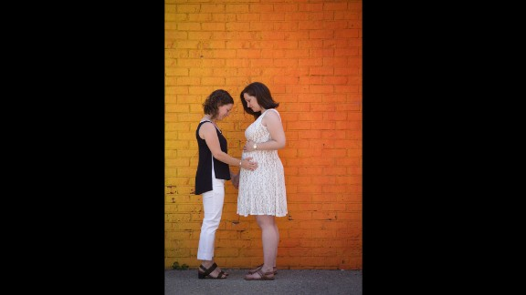 """Nathania, left, and Ilana Horowitz admire Ilana's pregnant belly carrying twins. They are both social workers living in Queens, New York, and have been together for five years. They are expecting a boy and a girl.  Having their marriage nationally recognized gives their family security, Nathania said. <a href=""""http://www.stevenrosenphotography.com/"""" target=""""_blank"""" target=""""_blank"""">Steven Rosen</a> photographed their wedding day."""