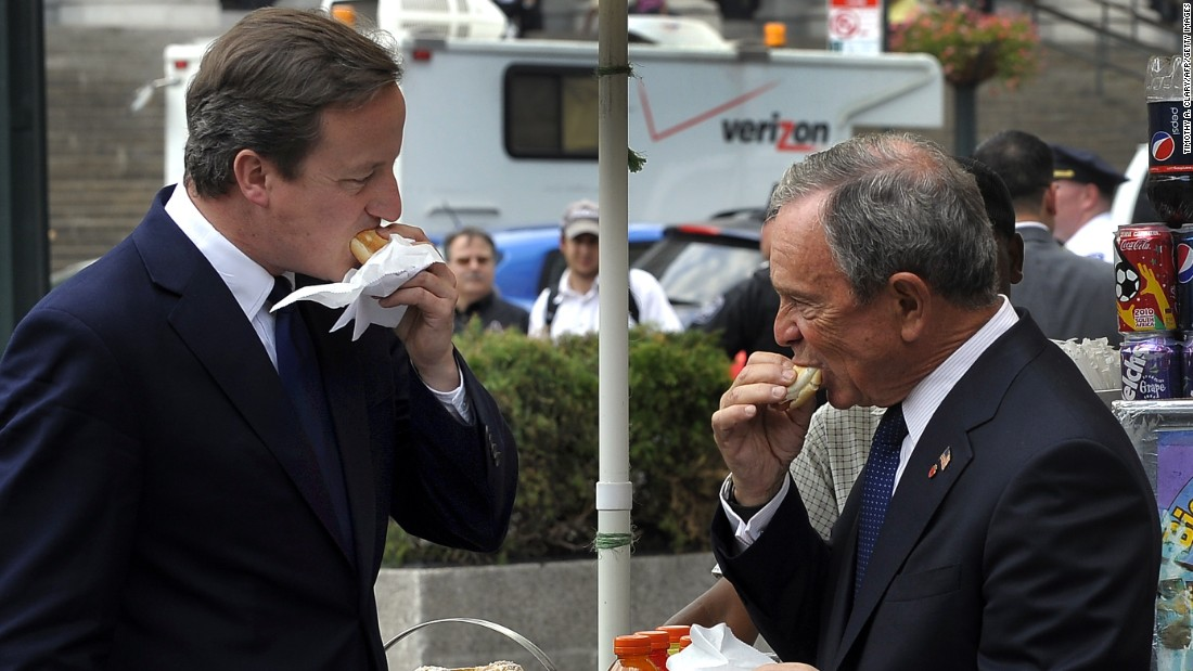 Then-New York Mayor Michael Bloomberg, right, and British Prime Minister David Cameron sample hot dogs outside Penn Station on July 21, 2010.