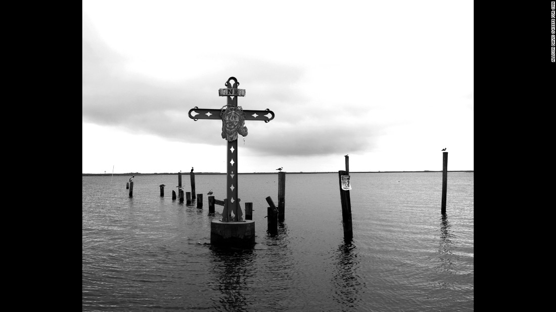 "A cross in the water off Shell Beach, Louisiana, honors victims of Katrina who were from St. Bernard Parish. According to FEMA, Katrina was ""the single most catastrophic natural disaster in U.S. history."""