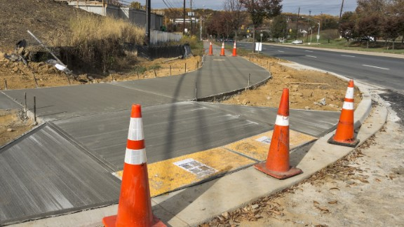 Curb cuts allow equal access to crosswalks, making city travel easier for people in wheelchairs.
