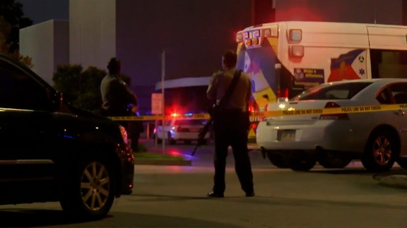 Police and emergency vehicles at the scene of the shooting.