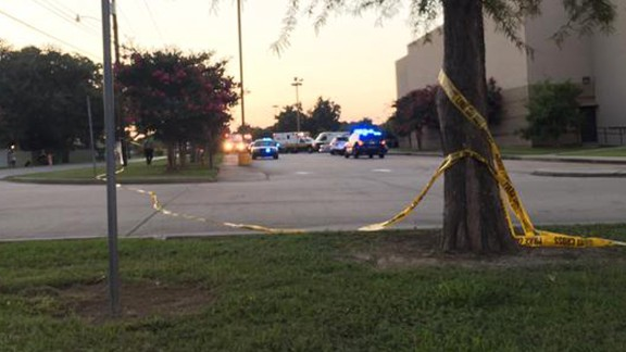 Police tape surrounds the scene.