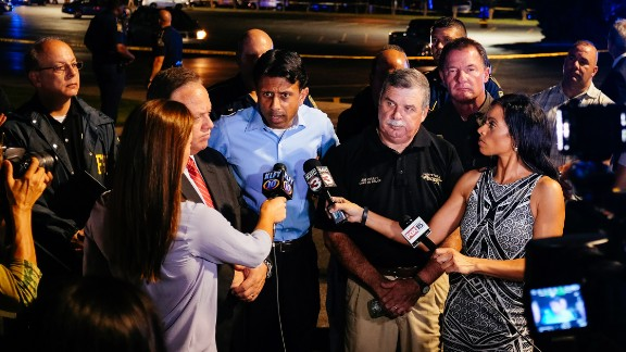 Louisiana Gov. Bobby Jindal, center, speaks with the media near the scene.