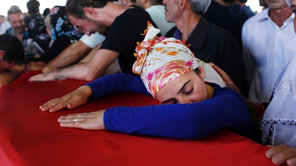 Mourners in Gaziantep, Turkey, grieve over a coffin Tuesday, July 21, during a funeral ceremony for the victims of a suspected ISIS suicide bomb attack. That bombing killed at least 31 people in Suruc, a Turkish town that borders Syria. Turkish authorities blamed ISIS for the attack.