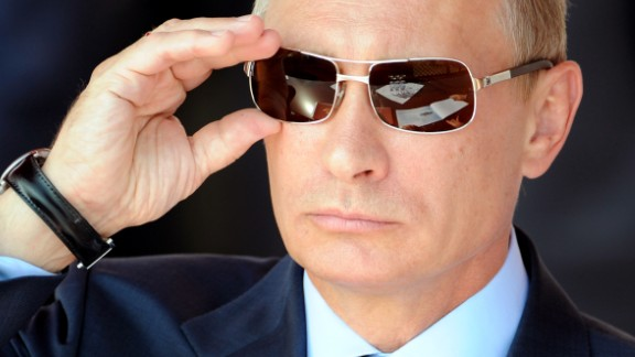 Russian Prime Minister Vladimir Putin adjusts his sunglasses as he watches an air show during MAKS-2011, the International Aviation and Space Show, in Zhukovsky, outside Moscow, on August 17, 2011. AFP PHOTO / DMITRY KOSTYUKOV (Photo credit should read DMITRY KOSTYUKOV/AFP/Getty Images)