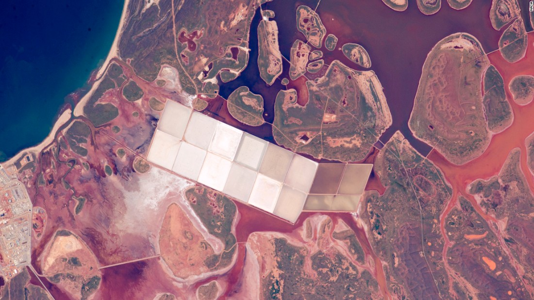 When astronauts look down at Earth from the International Space Station, they use coastlines to help them figure out which part of the planet they're flying over. This photo was taken by a crew member on the space station on June 6. It shows coastal lagoons with rounded islands along the Indian Ocean coastline of Western Australia. You can also see square, white ponds of the salt-extraction industry. This stretch of Australian coast has had more direct hits by cyclones than any other place on the Western Australia's coastline.