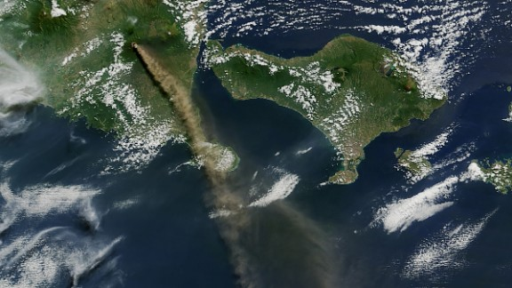 Mt. Raung is seen spewing ash and volcanic gases in this image taken on July 12 by NASA