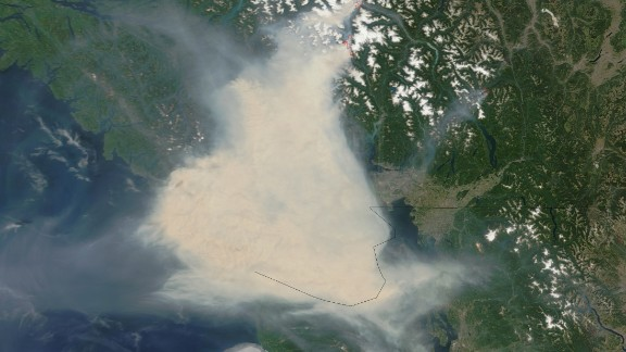 Fires in western Canada sent thick smoke over Vancouver and adjacent areas of British Columbia in early July. Some residents wore face masks for protection and health officials warned Women