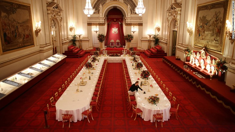 Table settings are laid out in the Palace Ballroom for a State Banquet at The Royal Welcome Summer opening exhibition at Buckingham Palace