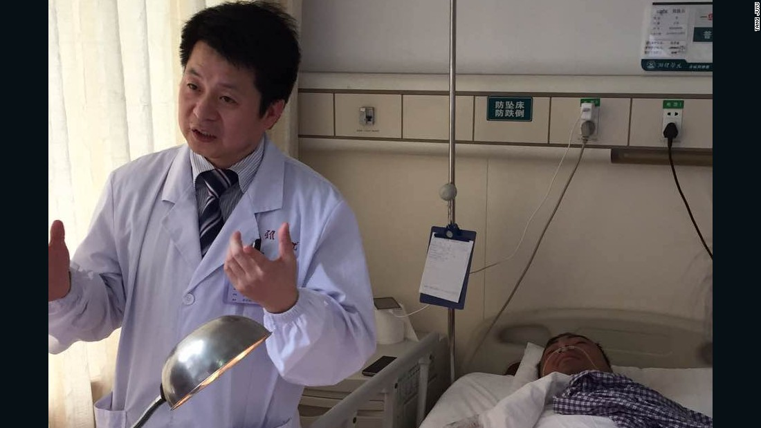 Dr. Tang Juyu, left, of the Xiangya Hospital in Changsha, in central China, led a surgical team that grafted a patient's severed hand to his leg. The patient, an industrial worker identified as Mr. Zhou, are shown following the grafting operation.