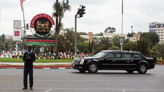 A security guard blocks a Nairobi street as Obama's motorcade passes on July 25.