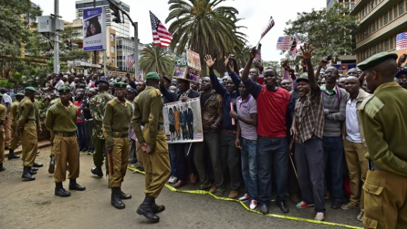 Crowds gather near Memorial Park in Nairobi to cheer Obama's motorcade on July 25.
