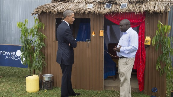 Obama talks with Michael Wanyonyi, CEO and founder of Mibawa Suppliers, on July 25 as he visits the Power Africa Innovation Fair, an initiative to increase the number of people with access to electricity in sub-Saharan Africa.